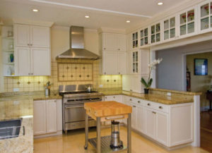 Giallo Ornamental Granite Countertops with Butcherblock Island